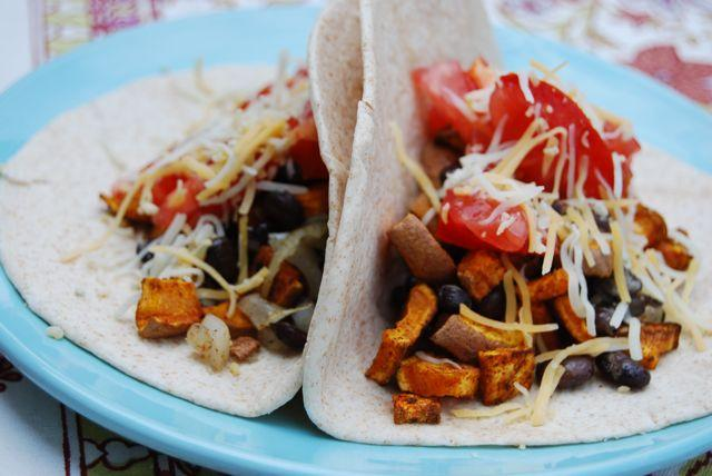 These Curried Sweet Potato & Black Bean Tacos make a hearty meatless meal any taco lover will adore!