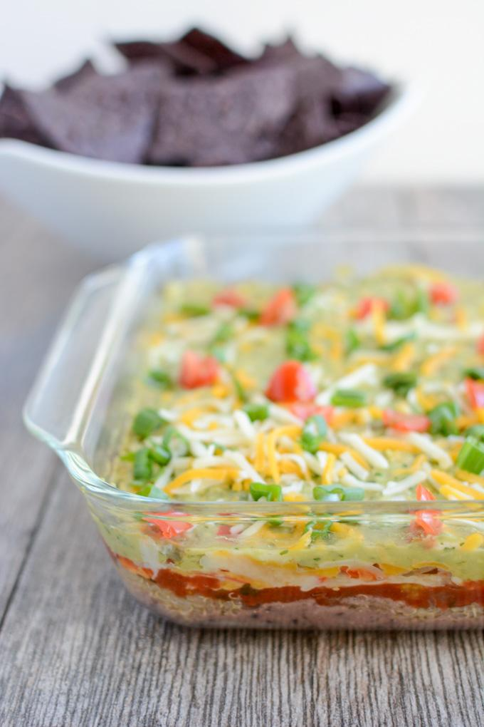 This recipe for Hot Mexican Layer Dip is an easy, healthy appetizer that's perfect for parties, game days and other gatherings. Plus it's full of protein thanks to the quinoa, cottage cheese and black beans so you can feel good about eating it!