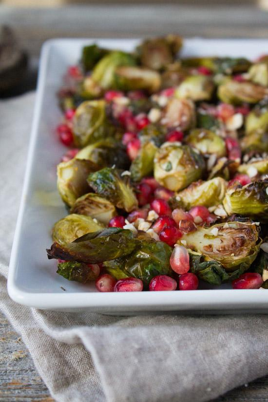 Brussels Sprouts with Pomegranate Seeds make beautiful holiday side dish. Bright red pomegranate seeds make these delicious, crispy caramelized Brussels sprouts pop with festive flair.