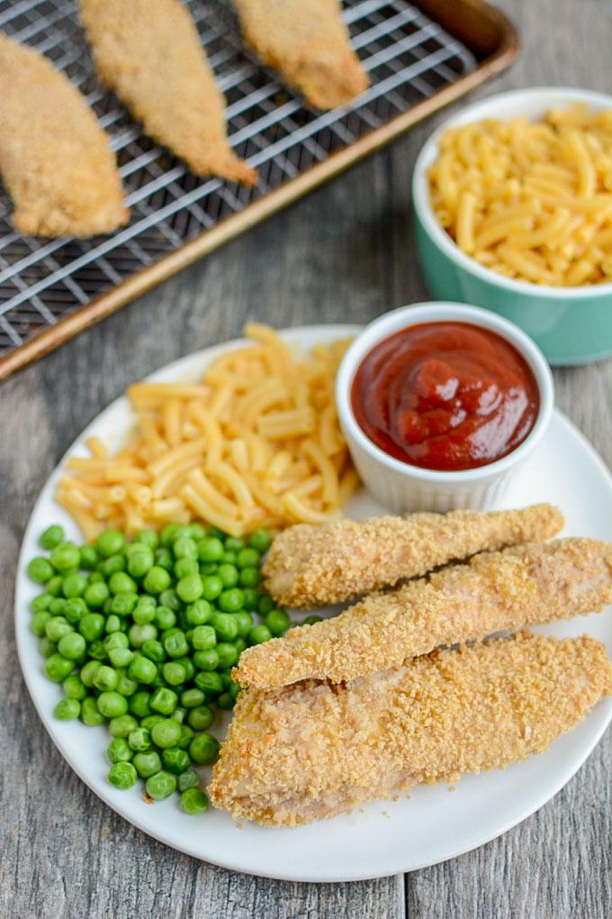 Freezer Chicken Tenders with steamed peas and mac and cheese for dinner