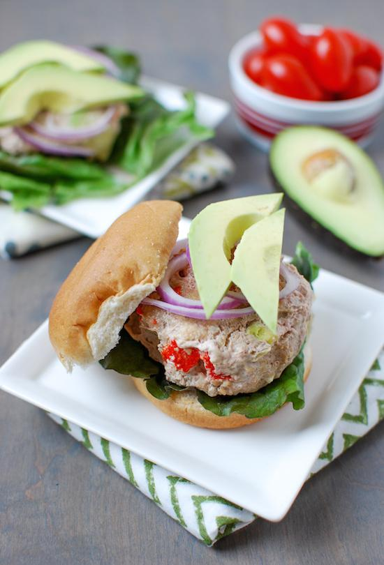 These California Turkey Burgers are packed with delicious flavors thanks to avocado, roasted red peppers and bacon. Perfect for grilling season!