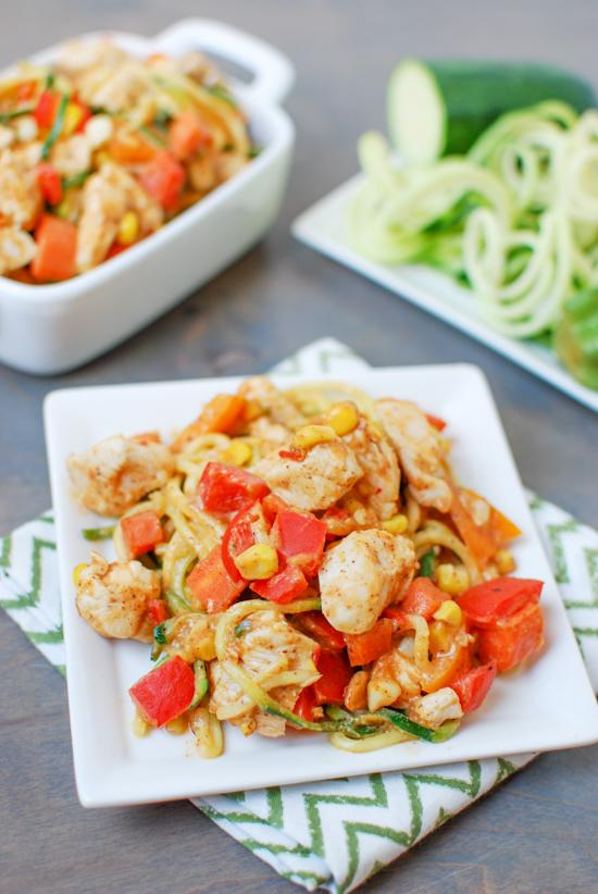 This recipe for Zoodles with Chicken and Spicy Almond Butter Sauce is low-carb, high in protein and makes veggies flavorful and fun to eat for lunch or dinner!