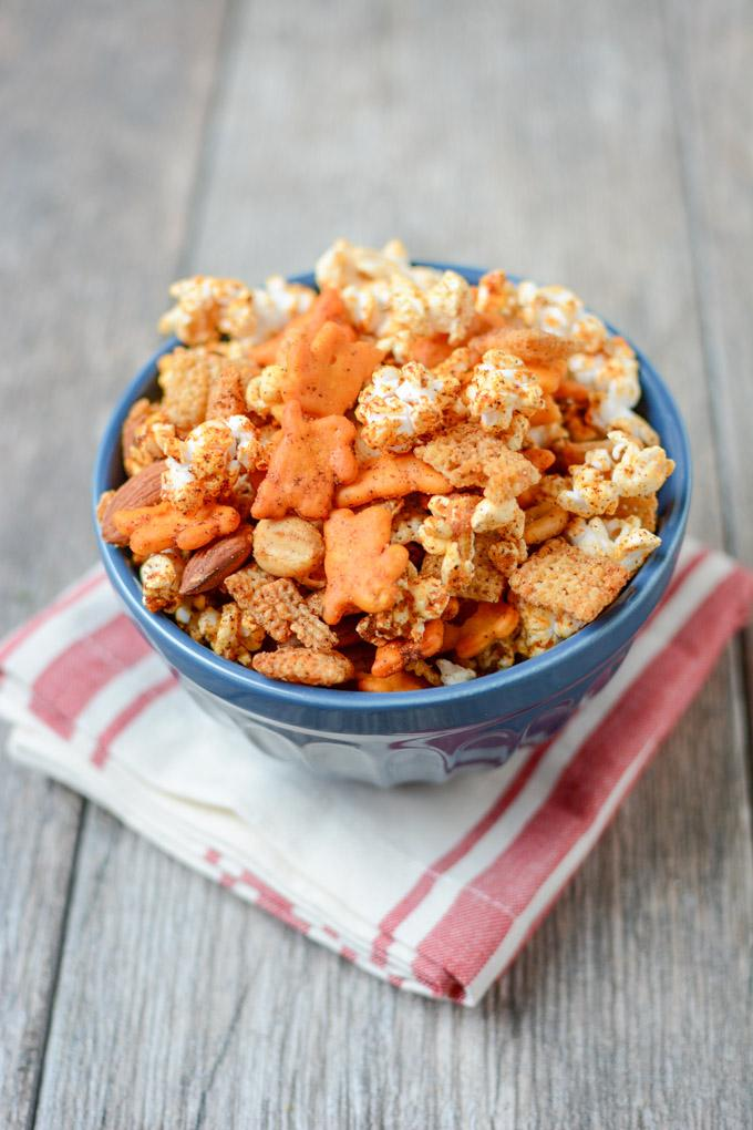 The perfect balance of spicy and sweet, this Popcorn Snack Mix is healthier than traditional Chex mix and highly addictive. Make a batch for your game day party or an afternoon snack.