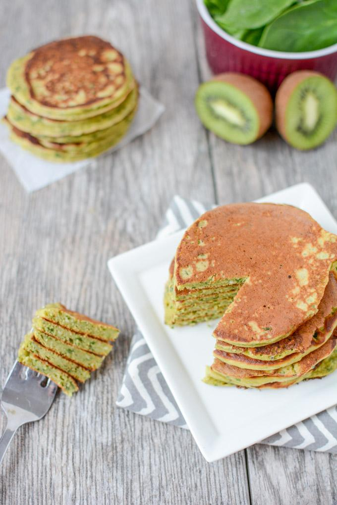 This recipe for Green Smoothie Pancakes has all the healthy ingredients from your favorite smoothie in pancake form so you can prep them ahead of time and reheating for breakfast during the week!