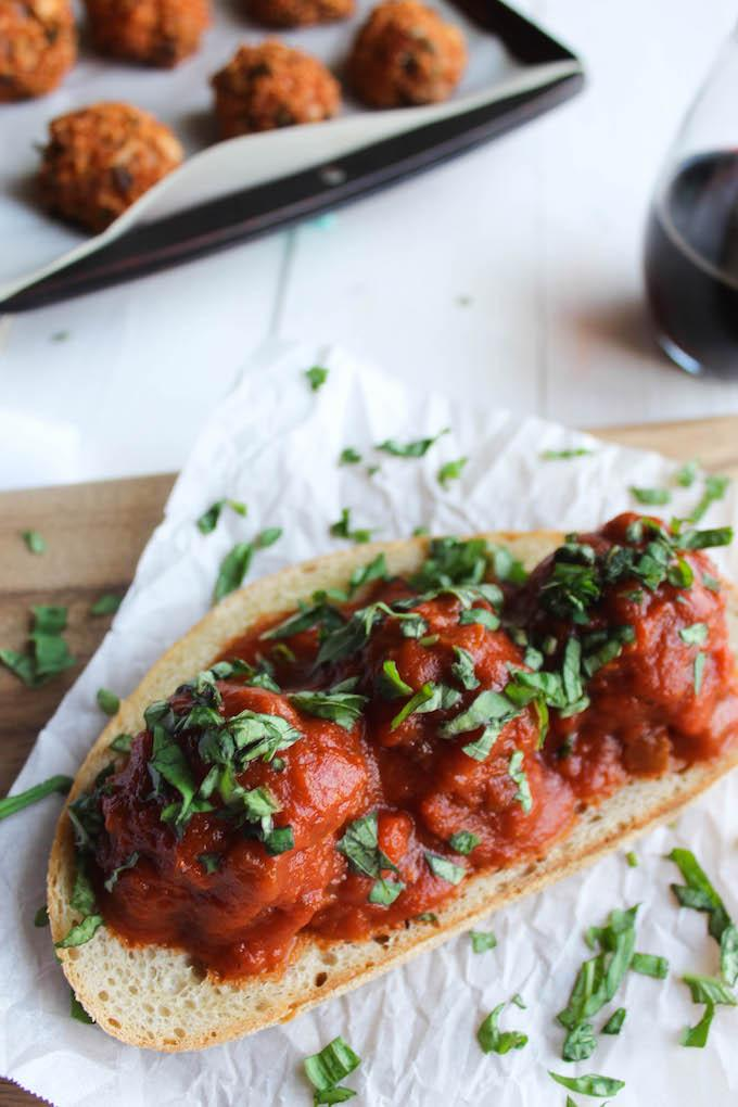 This Mushroom Quinoa Meatball Sandwich recipe is a great meatless alternative to your favorite meatball sub! Enjoy it with a glass of wine for an easy vegetarian dinner!