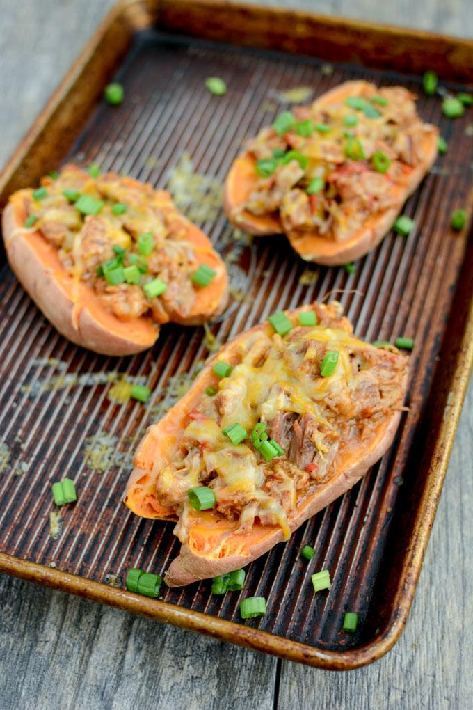These BBQ Pulled Pork Stuffed Sweet Potatoes are perfect for food prep. Make a big batch of pulled pork and sweet potatoes, stuff them ahead of time and reheat to eat for lunch or dinner.