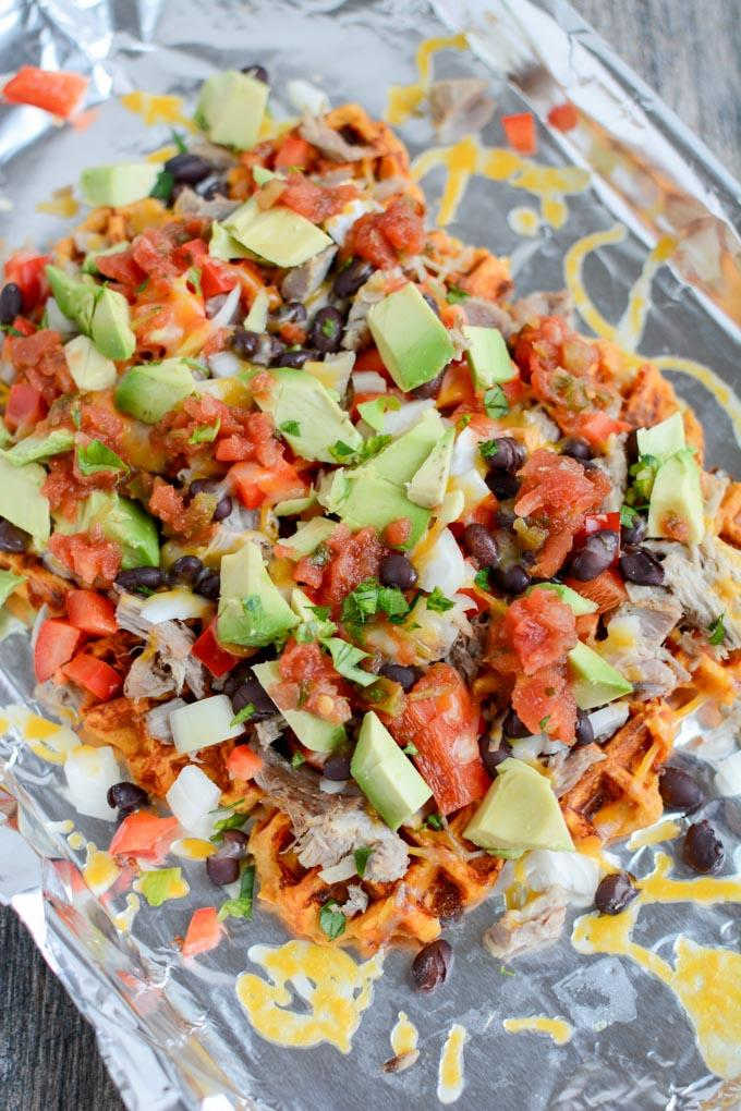 These easy Sweet Potato Waffle Nachos are a great way to transform leftover pulled pork or chicken into a healthy new lunch or dinner. This recipe would also make a great party appetizer!