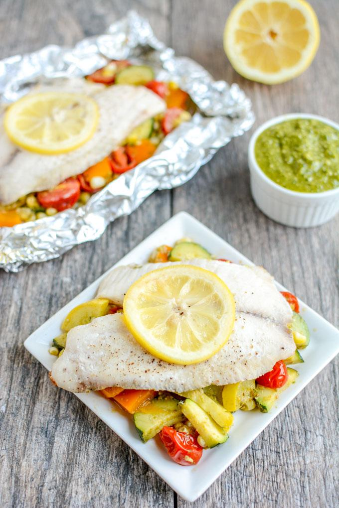 This recipe for Grilled Foil Packet Tilapia with Pesto Veggies is perfect for a summer dinner! It's quick, easy and healthy, plus cleanup is a breeze!