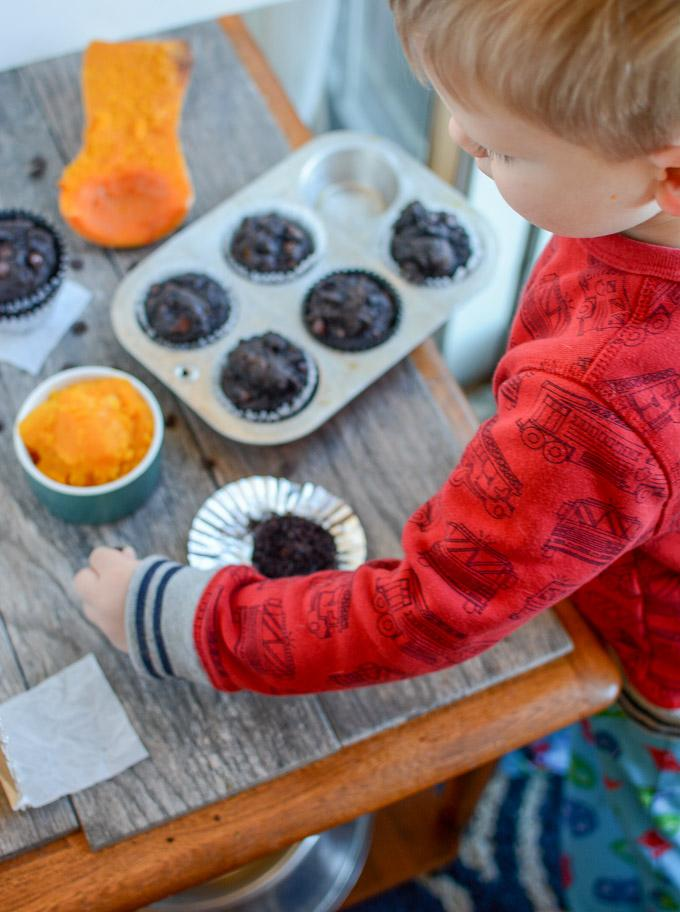Toddler eating Chocolate Squash Muffin