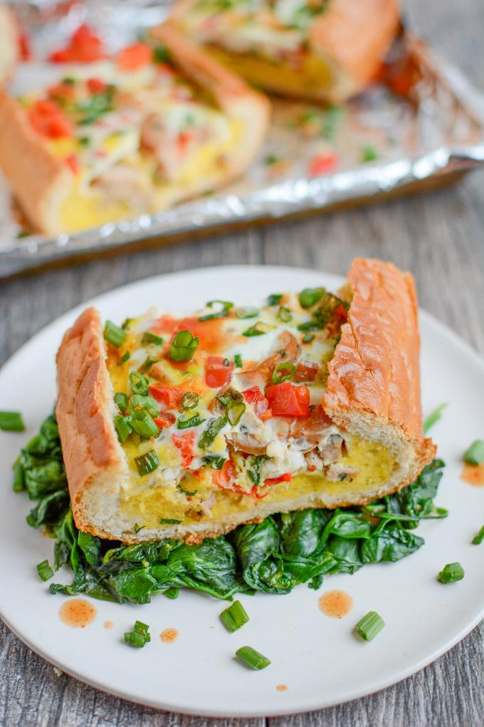 This Sausage and Egg Bread Boat is a perfect holiday breakfast or an easy brunch recipe! It can be prepped in just a few minutes and then you can just pop it in the oven and go spend time with your guests.