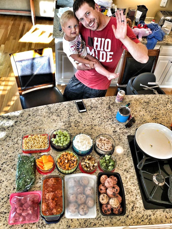 dad and toddler with food prep