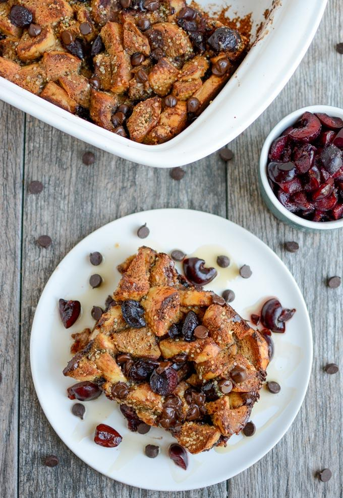Sweet Cherry Gingerbread French Toast Bake topped with maple syrup and chocolate chips