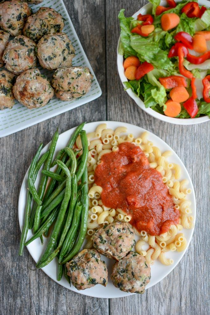 Spinach Feta Meatballs with pasta and salad