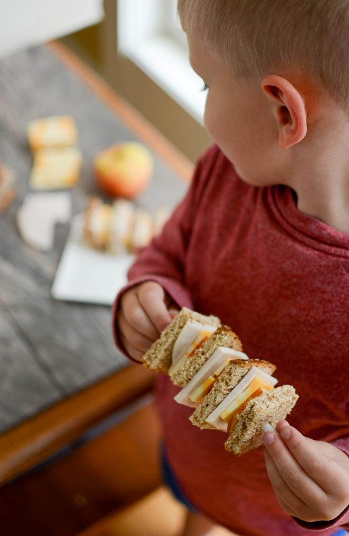toddler eating sandwich kabob