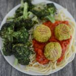 Pesto Lentil Balls over spaghetti with tomato sauce and roasted broccoli