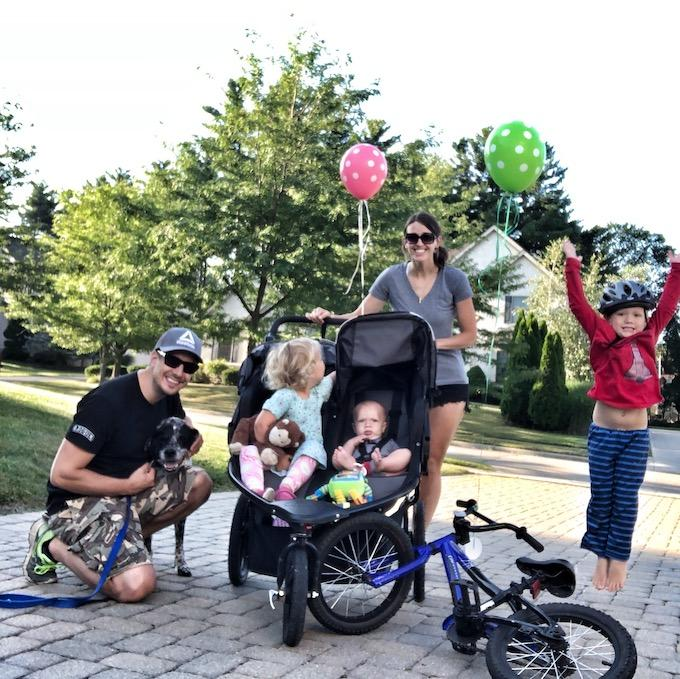 family celebrating walking and biking 100 miles over the summer
