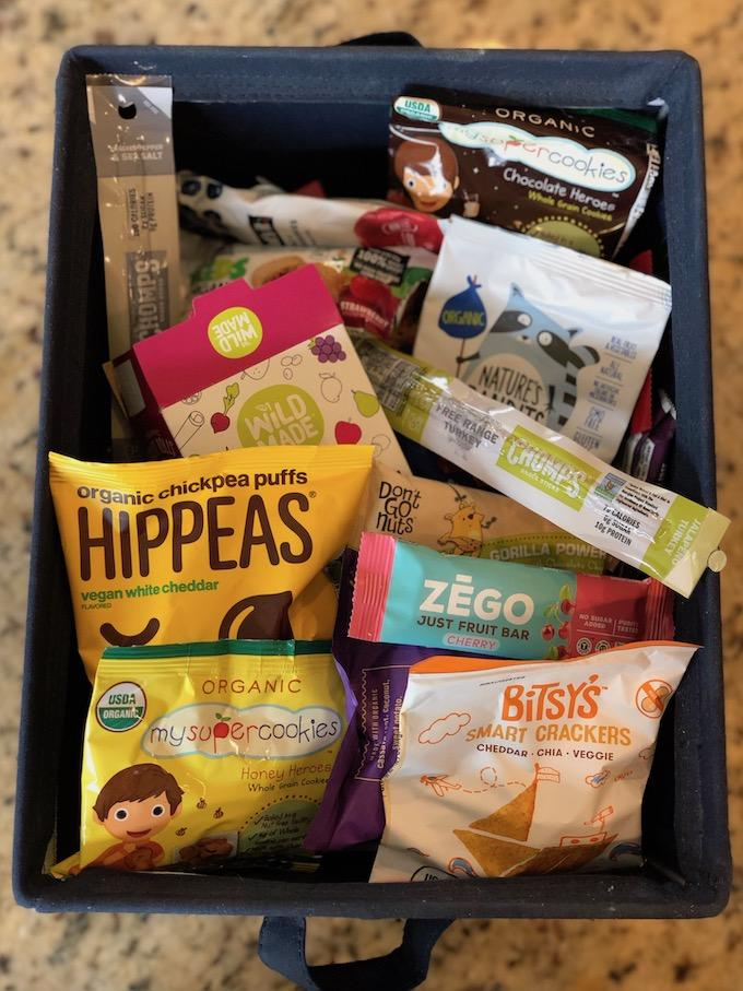bin of healthy packaged snack foods for school lunch packing