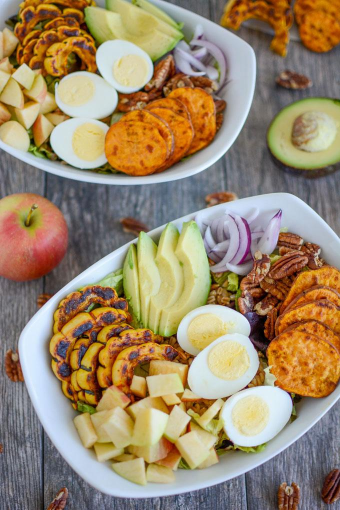 Roasted Squash Fall Salad with hard boiled egg and avocado