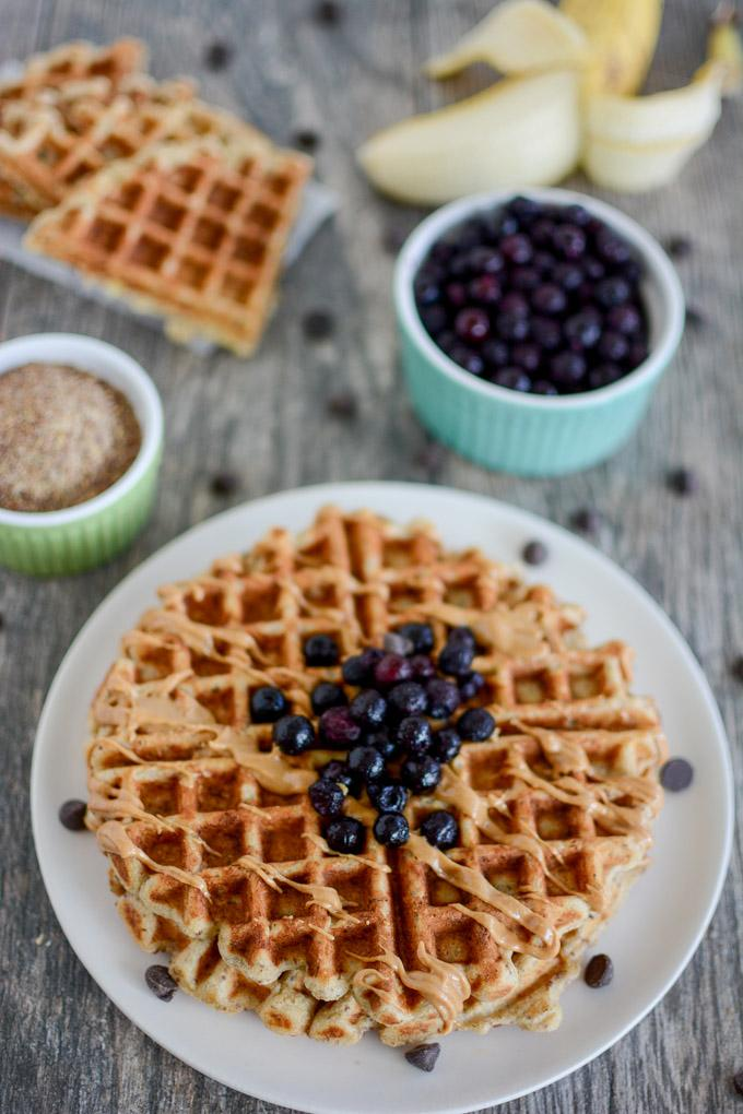 Banana Flax Waffles topped with blueberries and peanut butter