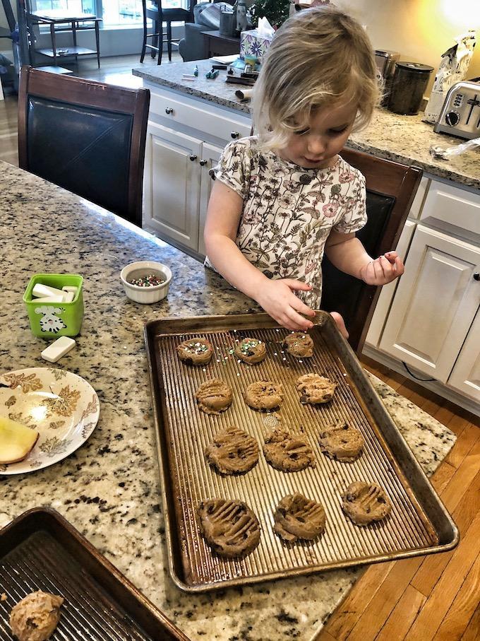 preschooler baking cookies