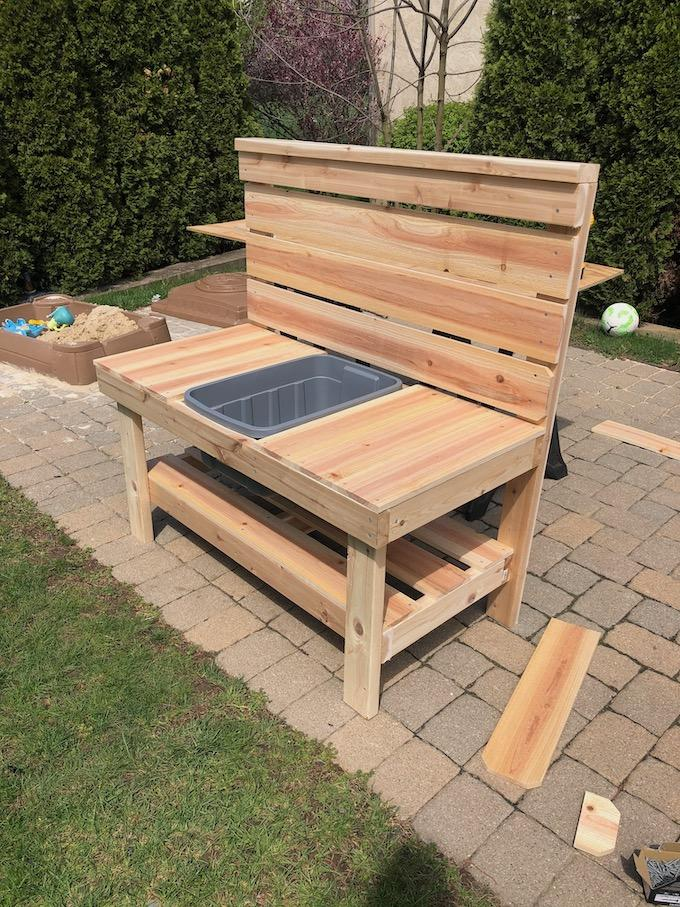 mud kitchen with cedar fence boards and 2x4s